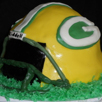 Green Bay Packers Superbowl 2011 Cake I made this cake for the 2011 Superbowl...Packers! I used 2 9-inch rounds, and 1/2 of a sport ball pan. (I would probably use 8 inch rounds...