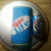 Miller Lite Can I made this cake from a loaf pan, rounded it out and then covered it in homemade MMF, used a 50/50 combo to make the label and painted logo...