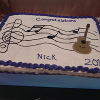 My Son's Graduation Cake two 9x13 cakes- half chocolate, half yellow with buttercream icing and fondant guitar(can't take credit for the guitar,my son's...