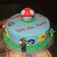 Mario Brothers Graduation Cake Made this for my son's friends...they love to play Mario Bros. at my house. Yellow cake with buttercream icing, stars are piped...