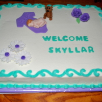 Baby Shower Cake With First Impressions Baby Mold This is my first time using the First Impressions Baby Mold. I thought she turned out cute. Cake is WASC with vanilla buttercream. Baby is...
