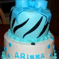 Zebra Stripe Birthday Cake With Bow And Stars This is my first tiered cake. Wish it would have turned out better but hopefully will taste good. Bottom is red velvet with cream cheese...