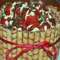 Strawberry Barrel Cake   WASC cake made for a friends birthday. Surrounded by pirouette cookies.