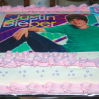 Birthday Cake With Edible Justin Bieber Image  This was for my 6 year old niece. She loved it. It's half chocolate and half funfetti with buttercream icing. Flowers are fondant...