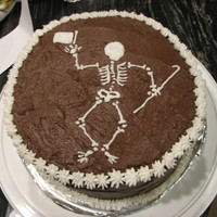 Dancing Skeleton This cake is covered in chocolate buttercream and I piped the skeleton on with white buttercream