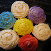Rose Cupcakes   I piped these with a cream cheese frosting. To make the colored ones I used a spray food color
