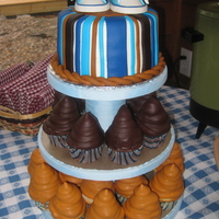Baby Shower Cake And Cupcakes 6 in cake with gumpaste shoes (THANKS to stellastarchild for the amazing template!) and hi hat cupcakes.
