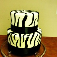 Elegant Zebra Cake This cake was made with fondant and I added a black ribbon for a perfect look.