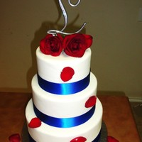 Wedding Cake With Blue Ribbon And Red Roses I love this cake. It's made with fondant, ribbon and fresh roses.