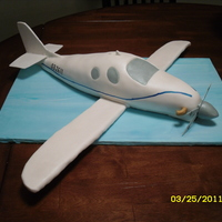 Lancair Evo Groom's cake for a guy that builds these planes. WASC with banana buttercream filling. Wings are RKT on wires, covered in fondant. TFL...