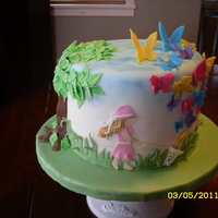 Spring Day Idea from CakeCentral Magazine. Made for my daughter's school auction. Everything is edible and made from MMF