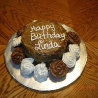 Linda's 41St Birthday German chocolate cake accompanied with buttercream and chocolate covered cup cakes