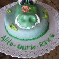 Grandpa-Saurus-Rex! This is a cake we made for my Grandpa's birthday!! He loved it!! It is vanilla cake with dulce de leche filling and vanilla icing,...