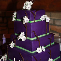 Purple Cherry Blossom Cake Wedding cake with alternating size tiers. Bottom tier is blue velvet to reveal sex of couples baby. I was the only person to know. It was...
