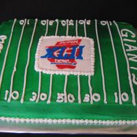 Superbowl Cake Made this for a friend's party. First time doing a FBCT...lemon cake with buttercream airbrushed green. TFL