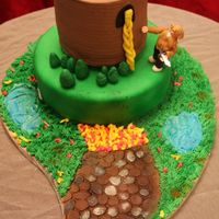 Rapunzel, Rapunzel Let Down Your Hair!! Chocolate, strawberry and lemon cake with marshmallow fondant and 50/50 figurine