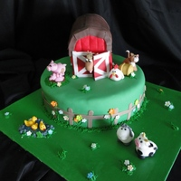 Farmyard Cake Base is chocolate sponge, filled with chocolate ganache and covered with sugarpaste. Barn is vanilla sponge filled with butter icing and...