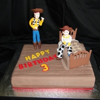 Toy Story Chocolate sponge covered in sugar paste. Characters are made from gum paste.