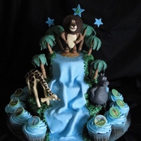 Madagascar Madagascar Cake for a 4 year old. Cakes are chocolate sponge with chocolate butter icing. Waterfall is made from sugar paste, animals and...