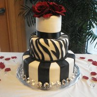 Black, Red And White Wedding Cake This was my first wedding cake! The bride had to book me last minute and I basically went off what she told me over the phone. When I...