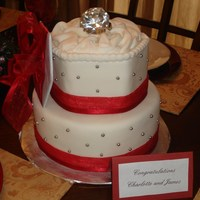 Engagement Ring Cake Cake was made with a 10 inch round base and a hand cut hexagon that was about 6.5 inches wide. The cake was covered in MMF and decorated...