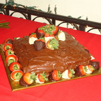 Strawberry Grooms Cake The cake is marble cake with our family fudge filling and frosting. Chocolate covered strawberries for decorations. Had many compliments...