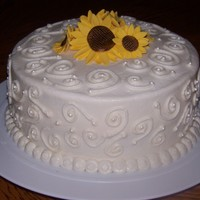 Sunflowers I loved making this cake! 8inch round covered in buttercream. Hand piped swirls and fondant sunflowers on top!
