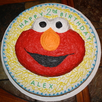"Elmo   Made this for my son's 2nd birthday. Elmo character pan on top of a 16"" round cake."