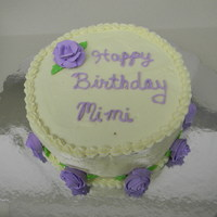Mother's Birthday Cake   Banana cake with cream cheese frosting and purple royal icing roses.