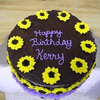 Mother-In-Laws B-Day   Chocolate cake with chocolate ganache and royal icing sunflowers.