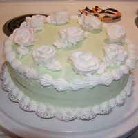 Boss's Birthday Cake I made this cake for my boss. I'm still practicing the Wilton rose!