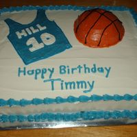 Basketball 12x15 with all butter buttercream icing and decorations. Half ball pan used for basketball, hand drawn jersey that I filled in. The number...