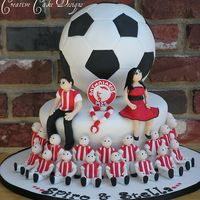 Soocer Players Grooms Cake  Handmade the entire soccer team from gumpaste (took two full days just to do that). MAde the grrom to be and bride to be out of gumpaste....