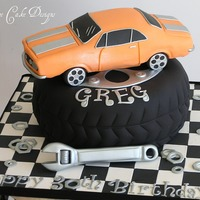 '67 Chevy Camaro   Car made from RKT, tire is cake and details are all gumpaste. Completely edible. =)
