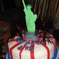Lady Liberty Statue is color flow. Red stripes and letters on cake are fondant. Created for a 4th of july party. This was a lot of fun to create!