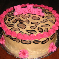 Leopard Spotted Birthday!   All spots are gum paste as well as the name and flowers. Yellow cake frosted in buttercream.