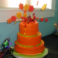 "Explosion Cake Bright orange buttercream 6 8 10 tiered cake for my son's ""explosions"" themed birthday party. Meant to look as if the..."