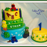 Sesame Street First Birthday Cake Red Velvet Cake filled with Strawberry N Cream filling with cream cheese icing covered in fondant. Smash cake is buttercream. Cute Cake! I...
