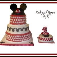 Mickey Mouse Cake  This cake was done for my nephew and it is yellow cake with fudge filling. The red tiers are fondant and the middle white and smash cake...
