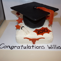 University Of Texas Graduation Cake 2010 Iced in buttercream with fondant decorations. I used a clay extruder for the tassel and the top of the cap is cardboard covered with...