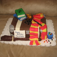 Potter Theme Cake chocolate cake with chocolate buttercream, fondant and gum paste details. Not perfect, but learned alot.