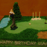 Golf Course All buttercream, golfer is plastic. Tree is made with an upside down ice cream cone.