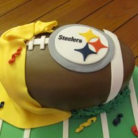Steelers Football Cake For The 2011 Superbowl This cake was for a friend of mine that wanted a Steelers football cake for her superbowl party. It is a red velvet cake with cream cheese...