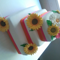 Gerbera Daisies And Sunflower Wedding Cake This cake was the first cake I made with flowers. Chocolate cake with french vanilla buttercream. The flowers were made with gumpaste and &...