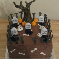 Spooky Graveyard   Chocolate cake with mousse filling. Figures are all made of gumpaste and tree is painted. TFL!