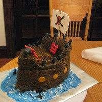 "Pirate Ship  This was for my nephew. It also had backyardigans figures on it that I made out of gumpaste. Cake is covered in fondant ""wood planks&..."
