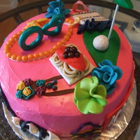 Personilty Cake This is a cake I made for a 60th Birthday. The cake highlights all the things the birthday girl likes.