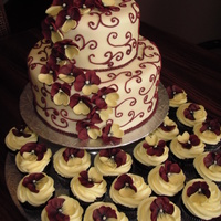 Burgundy Pansies & Scrolls  This is my first paid cake job! It was for a graduation party. Dark chocolate cake with Cointreau chocolate ganache filling. Iced in...