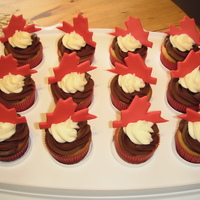 Canada Day Cupcakes!   Almond cupcakes with chocolate ganache and vanilla buttercream. Maple leaves are fondant.