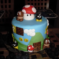 Super Mario Brothers Birthday Cake  This was a double celebration cake for my son and my brother whose birthdays are just a few days apart. They both love Mario, so this was...